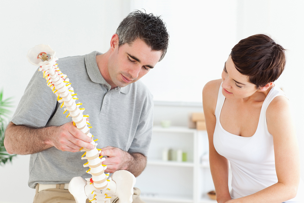 chiropractor explaining the services he offers