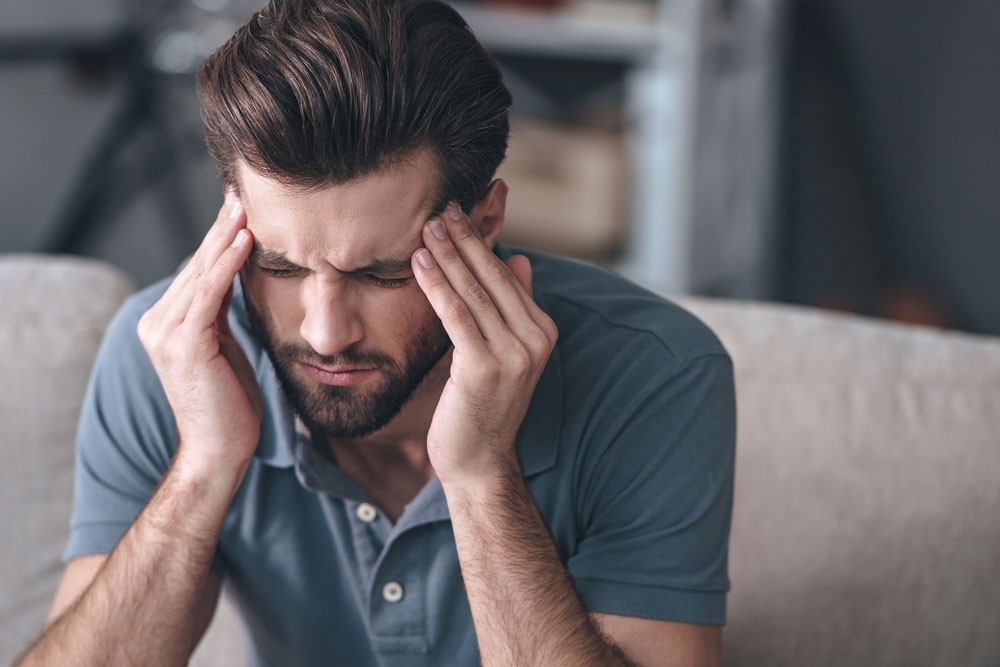 Man suffering from a headache or migraine